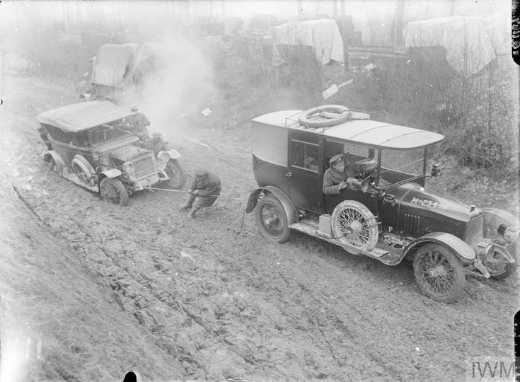 WWI, Jan 1917; British Army motor car, M-25446, towing a motor car out of the mud at Hamel. ©IWM