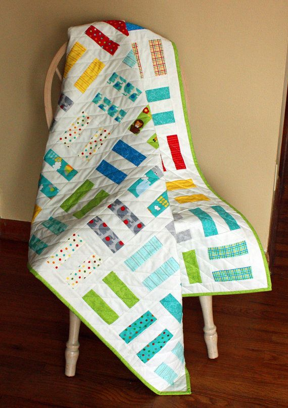 "Modern Baby Quilt for Boy or Girl in Moda ""Bungle Jungle"" Fabrics with White, featuring Animals in Rail Fence Pattern"