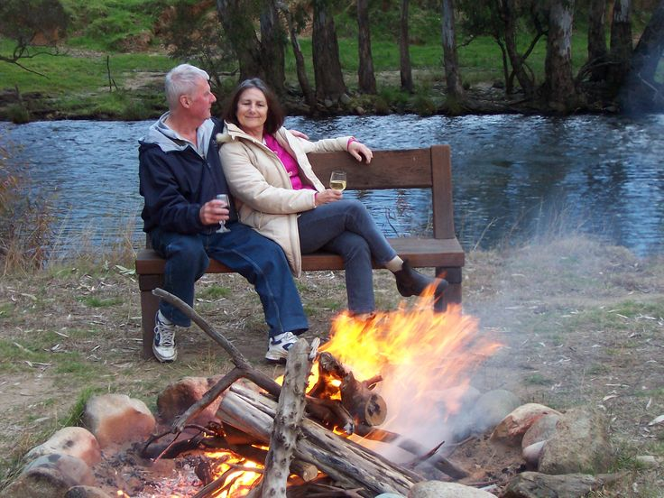 Enjoying a campfire by the river