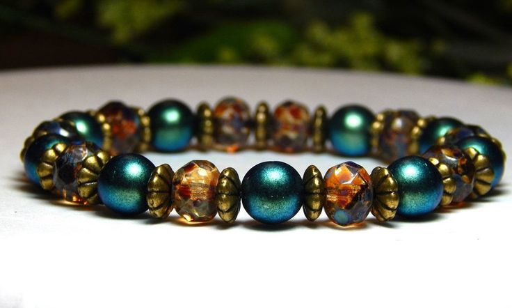 About the Bracelet A beautiful everyday rustic beaded bracelet. This gorgeous polychrome green pairs well with the rustic look of the Czech glass beads. Bracelet Details: This beautiful boho bracelet