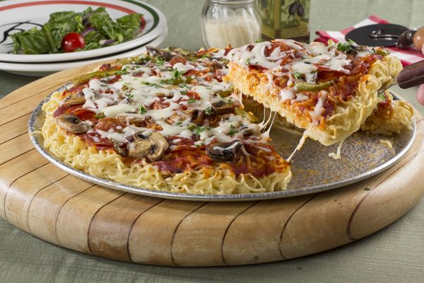 Imagine the look on your family's faces when you serve up slices of this Ramen Noodles Pizza Bake. They'll be so surprised that you were able to make two of their favorites, pizza & noodles, into one dish! This ramen noodle recipe is a real dinner winner.