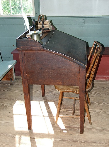 One room schoolhouse. This is exactly like my writing desk which we use in our schoolhouse. I had no idea it was a schoolhouse desk. Very cool!
