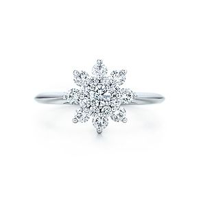 Flower ring with diamonds in platinum. They have a ring that is a little over 2000 but it doesn't come in my ring size (I have huge fingers) :( This one does!
