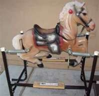 70's spring rocking horse..I used to get tangled up in the springs! Wonder how we survived with some of these crazy toys!