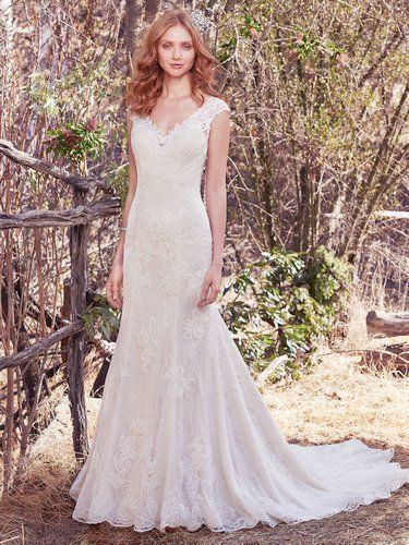 Maggie Sottero - TILDA, This fit-and-flare wedding dress features beaded lace appliqués atop allover lace. Lace appliqués adorn the illusion cap-sleeves, illusion V over sweetheart neckline, and illusion back. Finished with covered buttons over zipper closure.