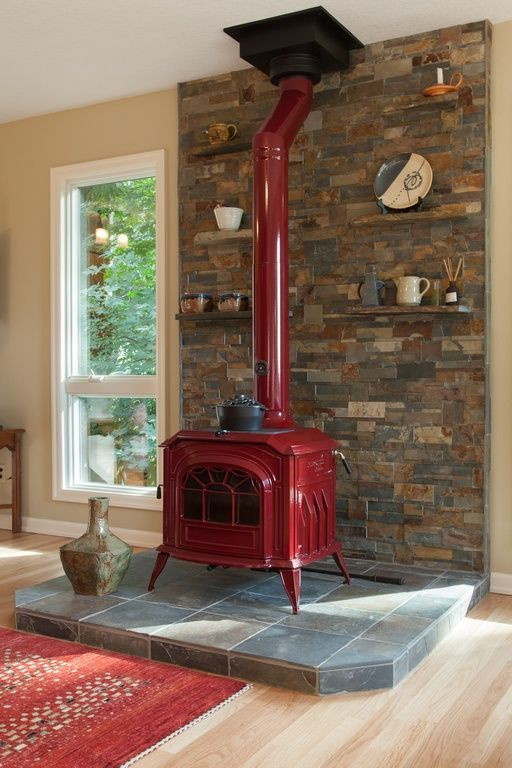Country Living Room with Fireplace, Hardwood floors, Breckwell cast iron wood stove red, Wood Stove fireplace
