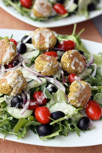 """Baked Falafel Bites with Creamy Tahini Dressing . This looks delicious.  I'm definitely going to consider adapting this for a """"meat free"""" entree on my Shrinking On A Budget Meal Plan."""