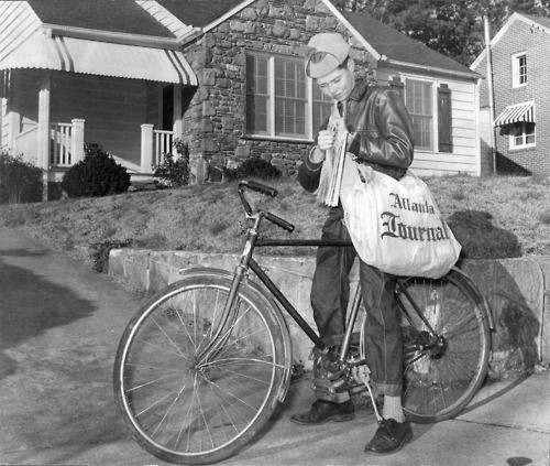 Newspaper delivery boy.