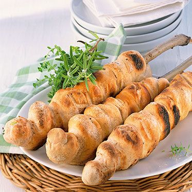 German Stockbrot! Bread on a stick, cooked and roasted over a campfire