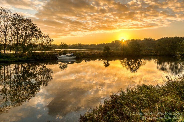 Sunrise in Norfolk reflecting in the river Yare near Norwich