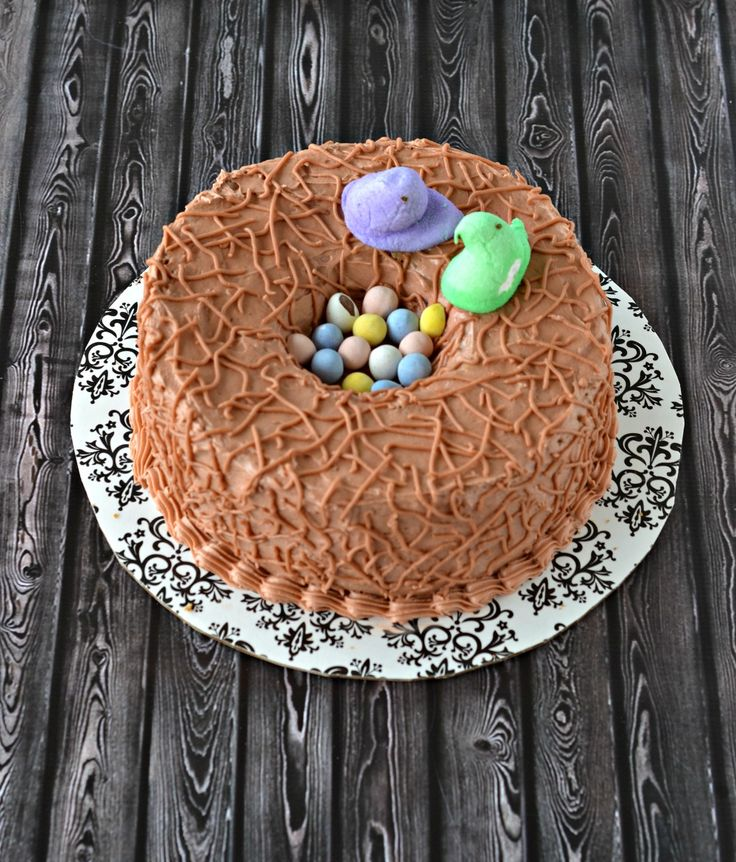 Finish your Easter meal with this gorgeous Carrot Cake Birds Nest Cake from Hezzi-D's Books and Cooks