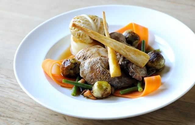 Roast partridge with seasonal vegetables and tarragon.