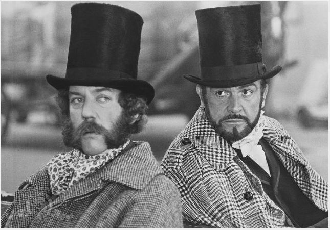 There's dapper, then there's Sean Connery and Donald Sutherland wearing houndstooth and giant top hat dapper in 'The Great Train Robbery' (1978). You'll never guess who wrote and directed the film: Michael Crichton. Yes, the Jurassic Park series Michael Crichton.