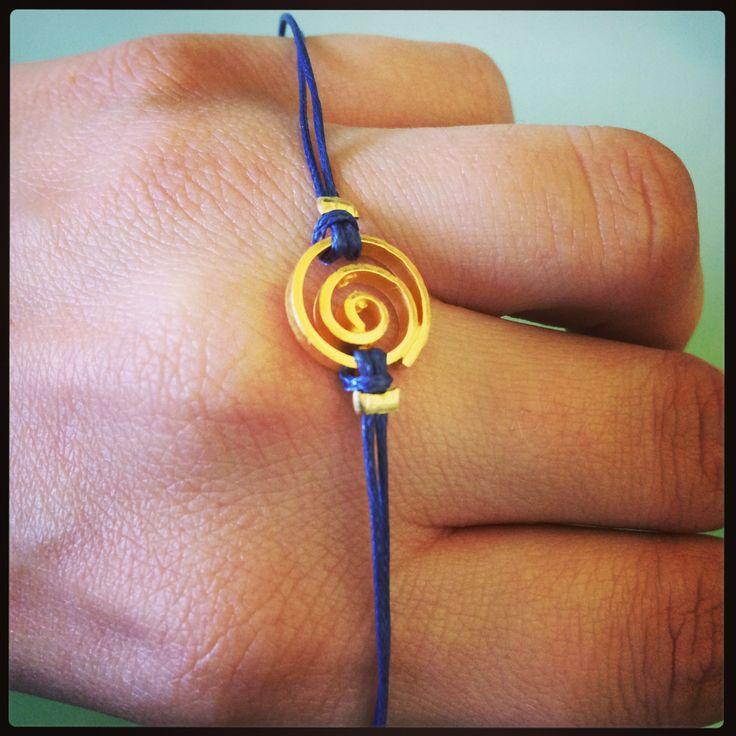 Gold plated spiral w blue macrame