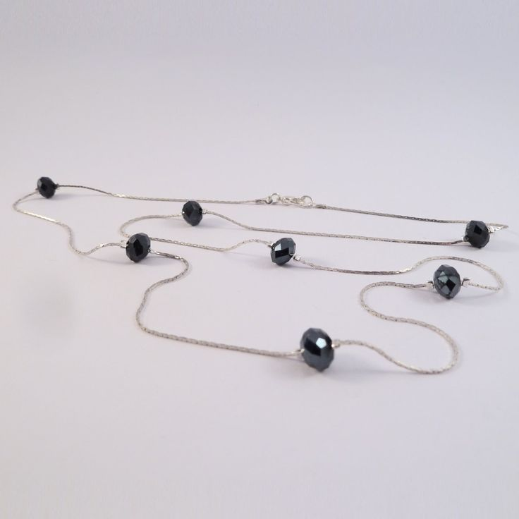 Swarovski elements floating necklace with black beads