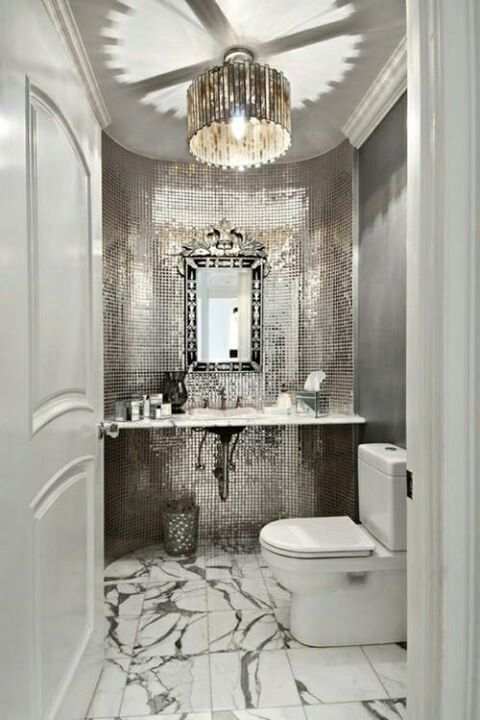 Talk about a GLAM Powder Room! Gorgeous mirror or metal accent mosaic tile wall and marble floor tile. #DesignPinThurs #TileSensations