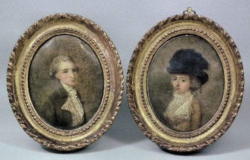 18th Century English School - Pair of miniature oil paintings - Half length portrait of a young woman, oval canvas 4.5ins x 3.75ins, and a ditto of a young man, oval canvas 4.5ins x 3.75ins (damaged), in carved gilt frames