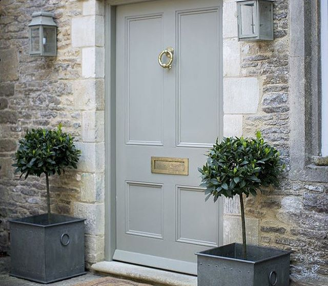 "Gorgeous grey door via - TONE ON TONE (@loithai) on Instagram: ""It's topiary time! So obsessed with these galvanized Tetbury Riveted Planters from Garden Trading…"""