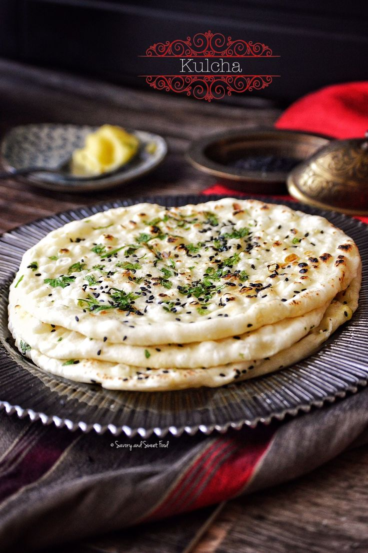 Soft and fluffy leavened Indian bread, KULCHA made with all purpose flour and yoghurt and cooked with a sprinkle of black sesame seeds and coriander leaves on top. I love homemade Indian breads as …