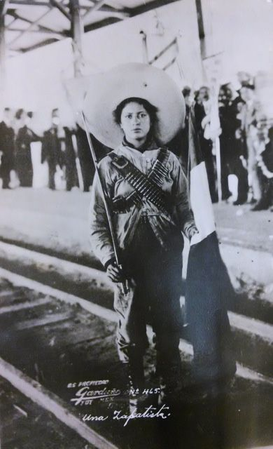 "Antonio Garduño, ""Una Zapatista,"" no. 465, n.d. Photographic postcard.  Collection of Mexican Revolution photographs, Collection 026. UCR Library, Special Collections & University Archives, University of California, Riverside."