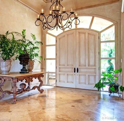 Love this foyer... the windows naturally light it and the large double doors are grand.