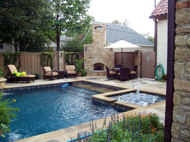 rectangular pool, hot tub and fireplace