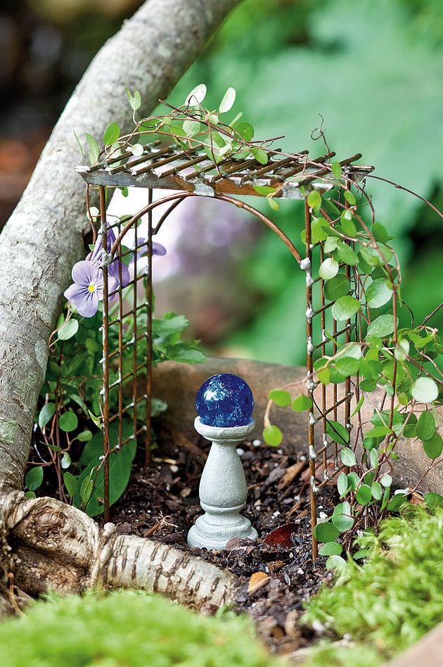 Jeremie | Mini garden arbor and gazing ball.
