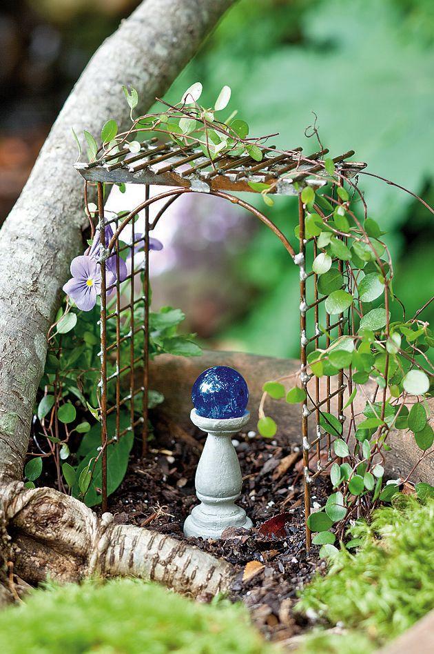Jeremie | Mini garden arbor and gazing ball.