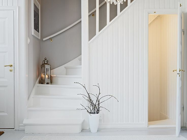 lovely white and grey stair case .. down to basement this is such a nice way to join the space! love the white wood and soft tones