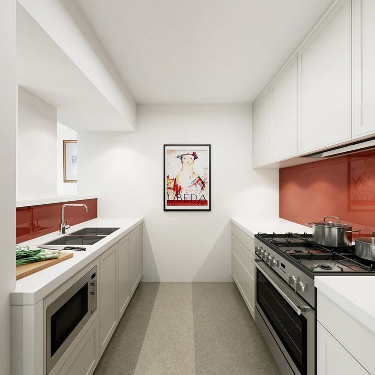 A splashback in red really livens up the kitchen in this North Sydney Apartment