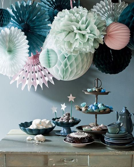 Honeycombs are back as seen here in a colorful mix with poms and fans