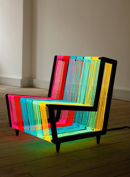 The Disco Chair by Kiwi  Pom is a bespoke illuminated furniture concept. Constructed from 200 linear metres of Electroluminescent wire, the chair transforms into a neon rainbow when powered. A pulse setting enables the chair to flash on and off creating an instant disco installation.