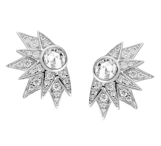 Jade Jagger - Stellar Earrings A constellation of round diamonds—nearly a half carat in all—orbits around rose-cut stones in interstellar settings of 18-karat white gold.