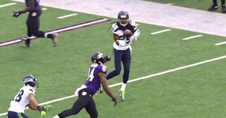 Seahawks cornerback Richard Sherman intercepts Ravens quarterback Jimmy Clausen.
