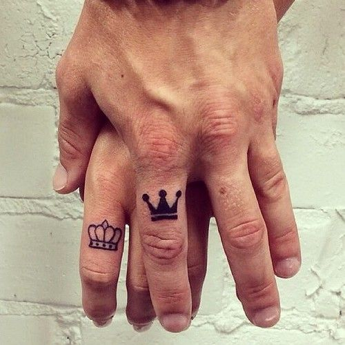 couple with crown finger tattoo