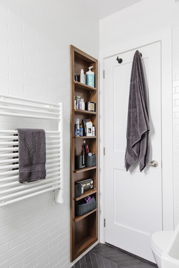 A custom built-in shelf is a lovely medicine cabinet alternative for storing bath necessities!