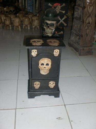 """Vault w/ Skulls 9"""" X 14"""" - Crossbones Decor by Tikimaster. $39.90. Here is a vault with skulls, featuring hand carved skulls. This cross bones armoire will be a great addition to your skully room.Specifications:- Measurement: 9"""" X 14""""- Wood: color black and whitePerfect piece of decor for your skull and bones theme room or pirate decor!"""