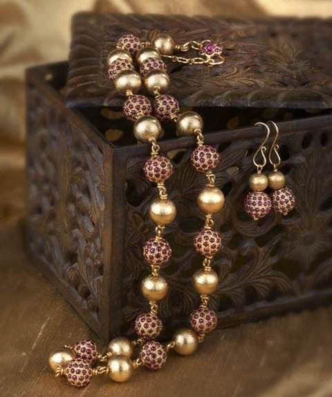 Contemporary South Indian Mala set: Ruby studded gold and textured beads come together to form this mala with earring set.