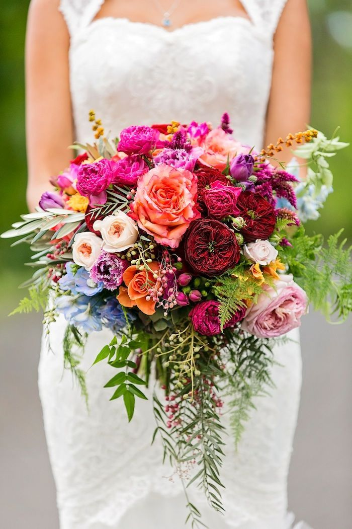 We can't get enough of these brilliant summer wedding colors--fuchsia, marsala, light pink, and hints of blue, and tangerine! Photo: Calli B Photography