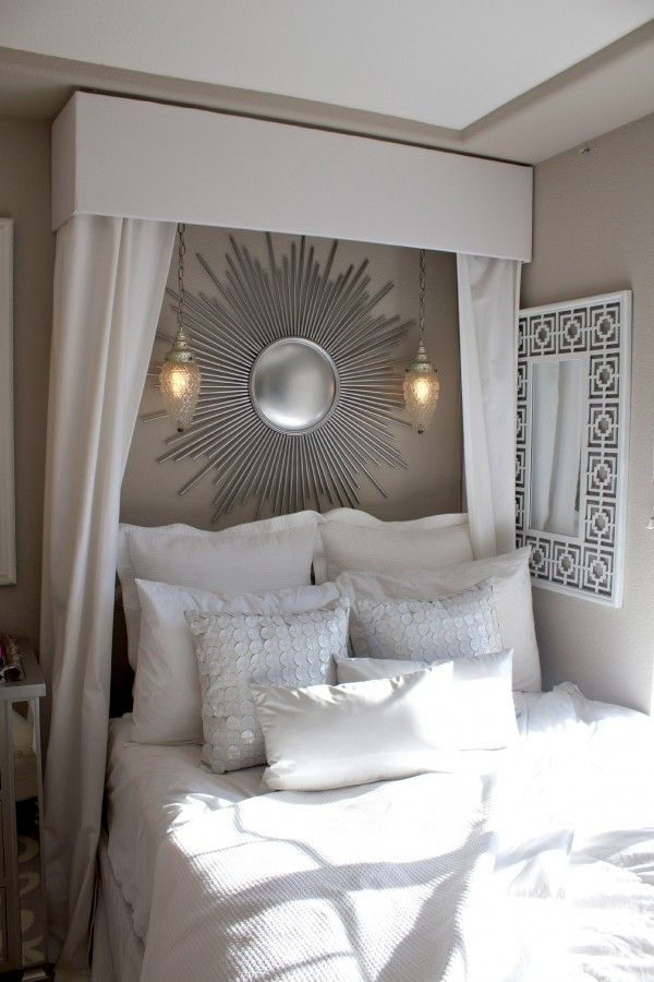 DIY White Linen Canopy Bed ! An excellent way to hide those pipes in our bedroom (plus it's super cute)