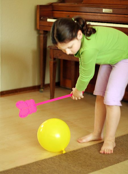 Balloon + fly swatter = great boredom buster!