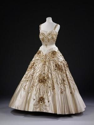 Evening Dress worn by Queen Elizabeth II | Norman Hartnell | c. 1957 Lavish gold and white beadwork encrusts this ivory evening dress worn by Queen Elizabeth II on a state visit to Paris in 1957. Victoria and Albert Museum by gladys