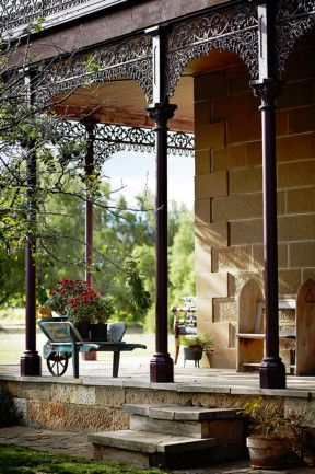Verandah 5. A sweeping verandah surrounds this grand property which provides plenty of seating options and whimsical elements including bright pot plants displayed in an old wheelbarrow.