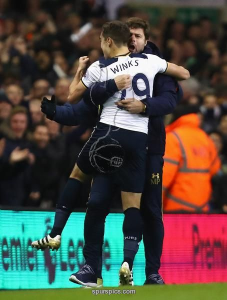 LONDON, ENGLAND - NOVEMBER 19: Harry Winks of Tottenham Hotspur (L) celebrates scoring his sides first goal with Mauricio Pochettino, Manager of Tottenham Hotspur (R) during the Premier League match between Tottenham Hotspur and West Ham United