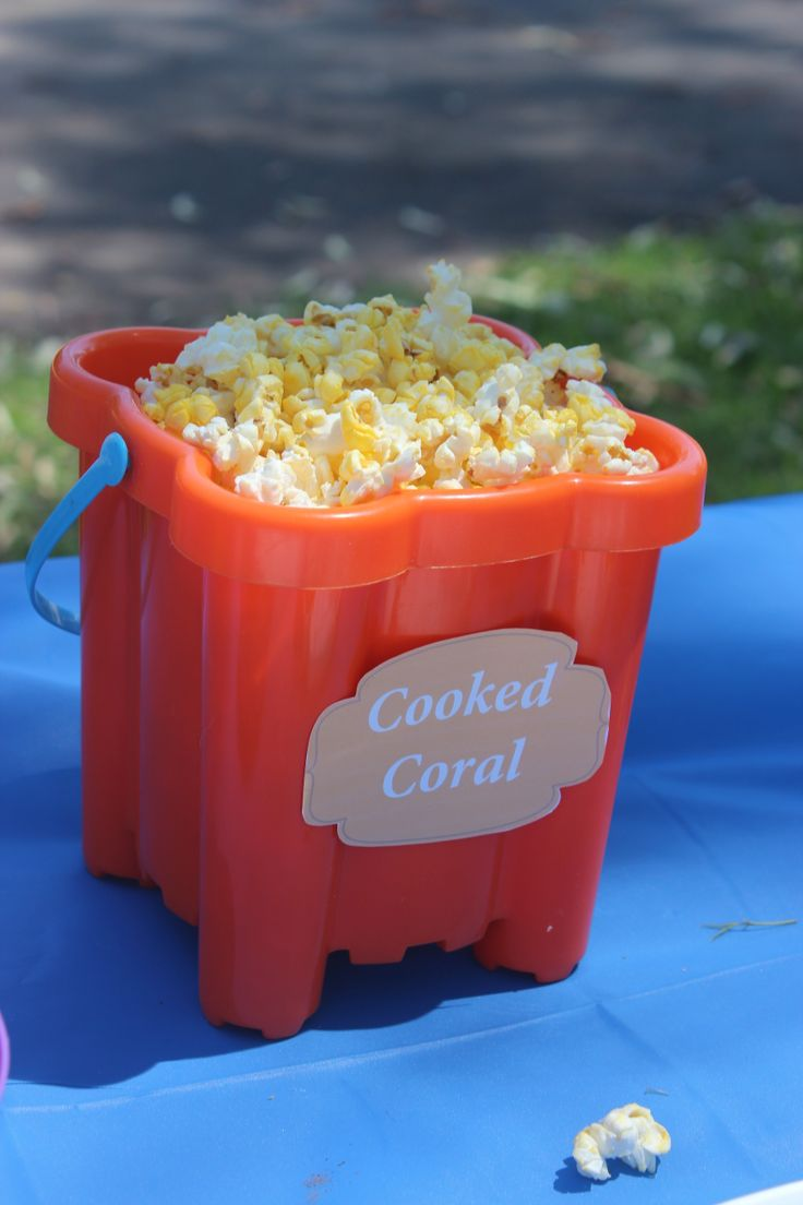 Play on Words - Popcorn (cooked coral - the kids came up with this one) Remember it doesn't have to be fancy - you want the kids to eat! Cheap Kmart bucket to add to the theme and can be used later in the pool/beach