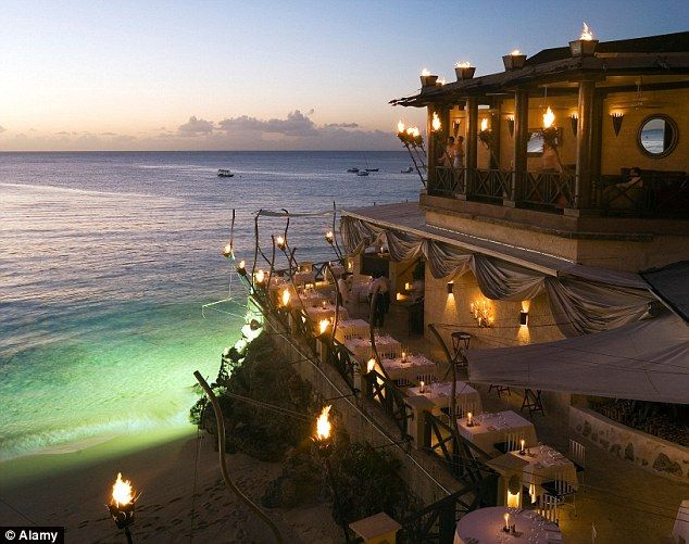 Star-studded: The Cliff Restaurant in Barbados is a celebrity favourite and is located nea...