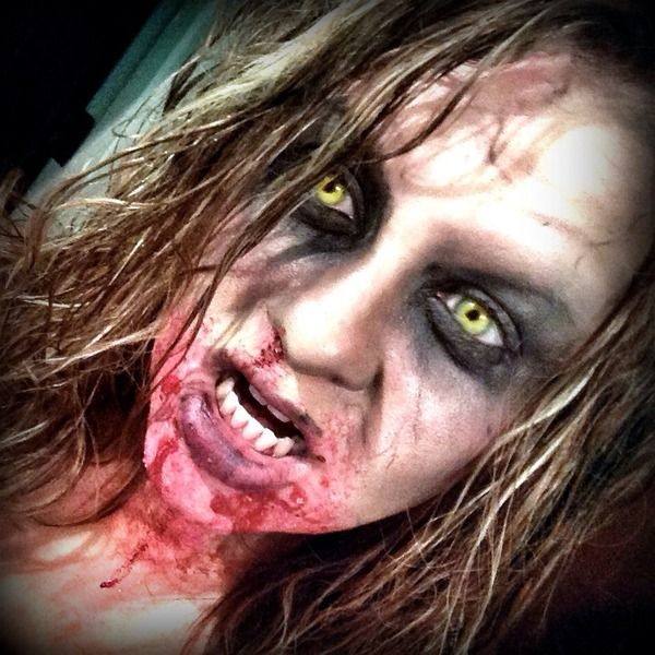 won't get contacts just for zombie night at work tomorrow, but i like the simple make up she uses.