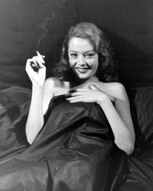 Jane Greer in Out of the Past (1947) back in the days it was considered glamish to blow smoke in the mans face. Considered a come on in the movies. I made up the word glamish :)