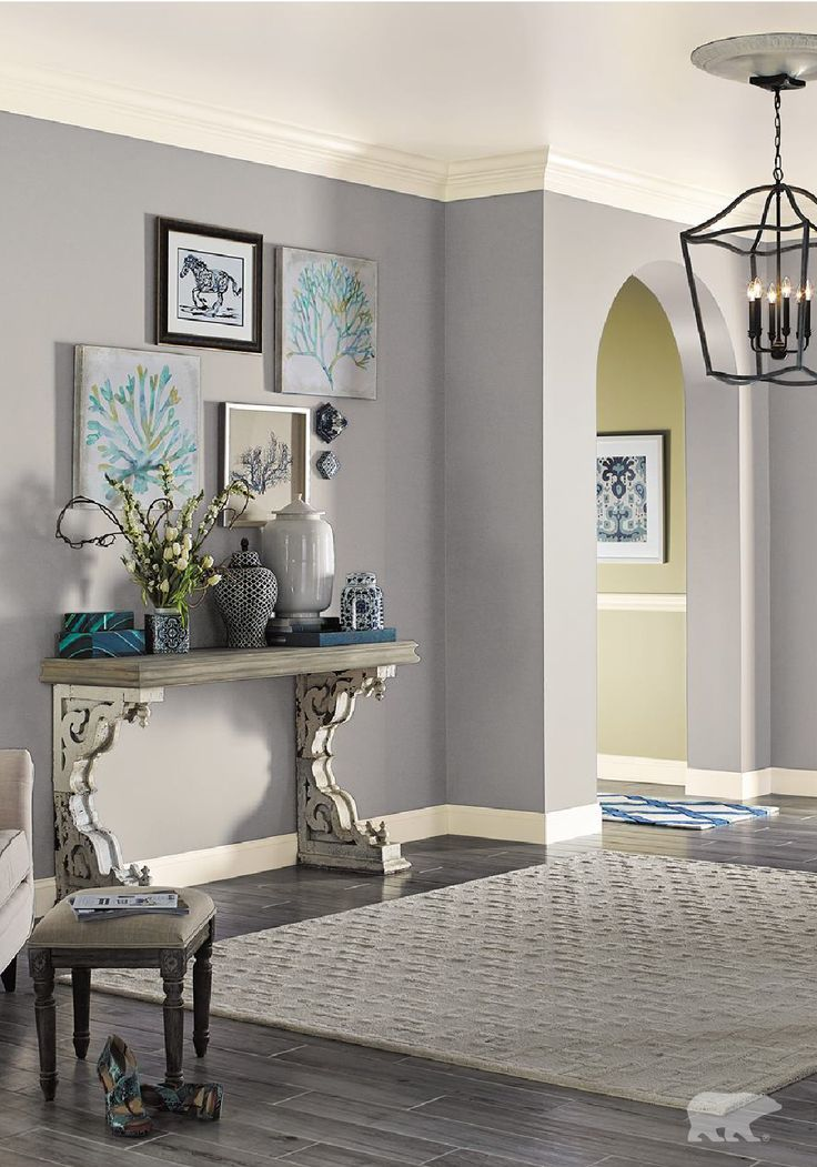 Fresh Olive is the perfect cool-toned gray to use in your entryway makeover. No matter what your personal style may be, whether it's traditional, country chic, or modern, this paint color is the ideal backdrop to a variety of home decor accents.
