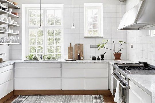 White cabinets, wood toekick  /// The Often Neglected Small Detail that Could Make a Big Difference in Your Kitchen